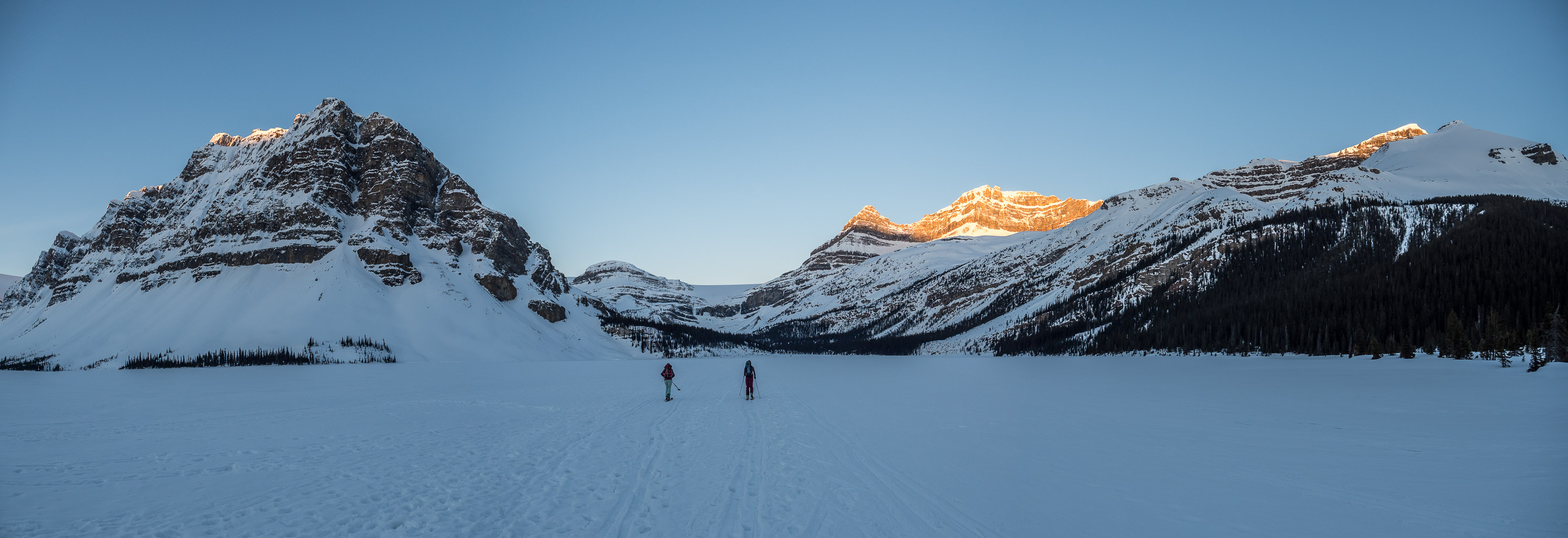 A gorgeous sunrise as we ski across Bow Lake.
