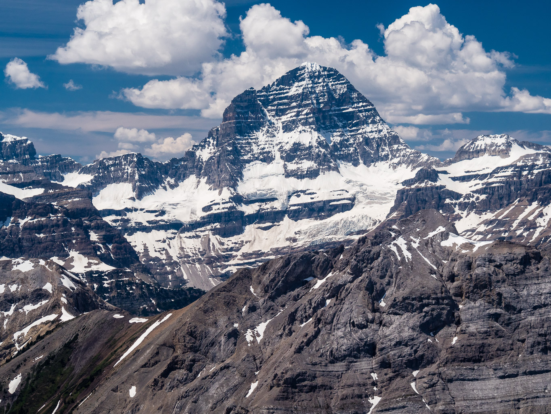 Mount Assiniboine looms over Marvel Peak.