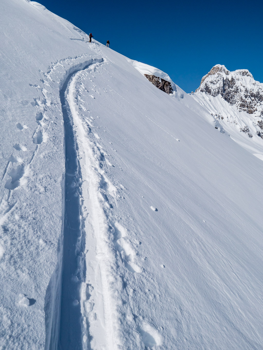 "On large open snow slopes the terrain can sneak up on you. This is that ""small roll"" from the previous photo.."